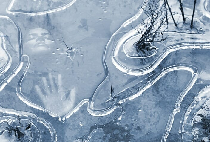 trapped under ice frozen lake